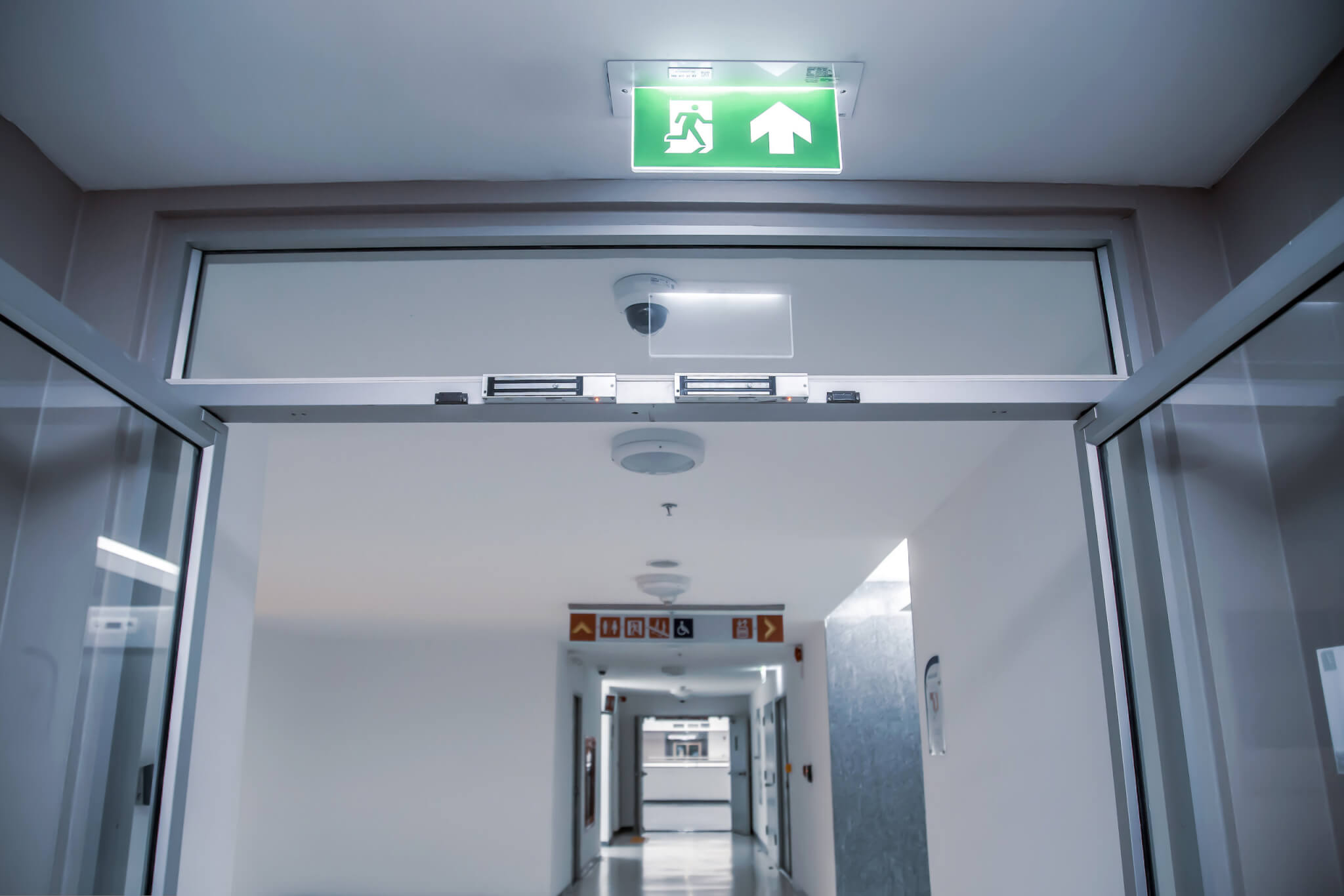 Emergency exit sign and exit gate or fire exits in the building Ideas for evacuation drills in the event of a fire