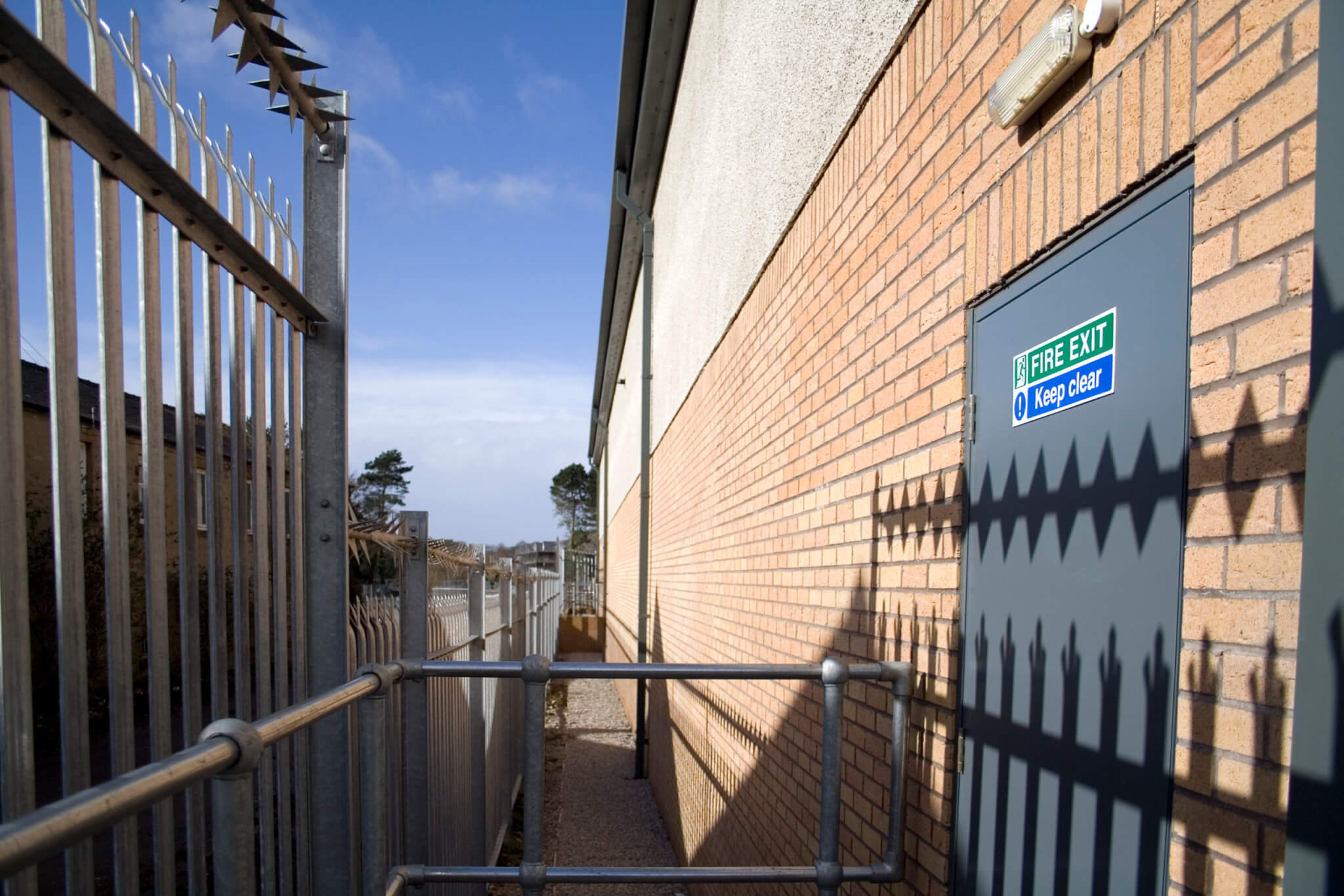 security fence around industrial building with fire exit