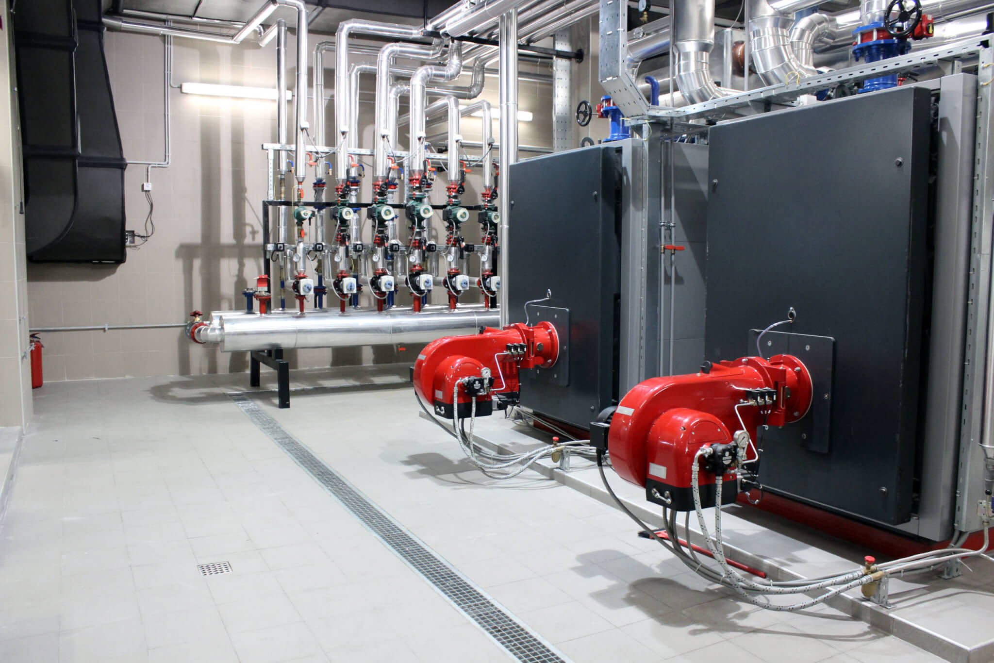 Interior of a room with boiler, and cooling system for industry or building cooling and heating